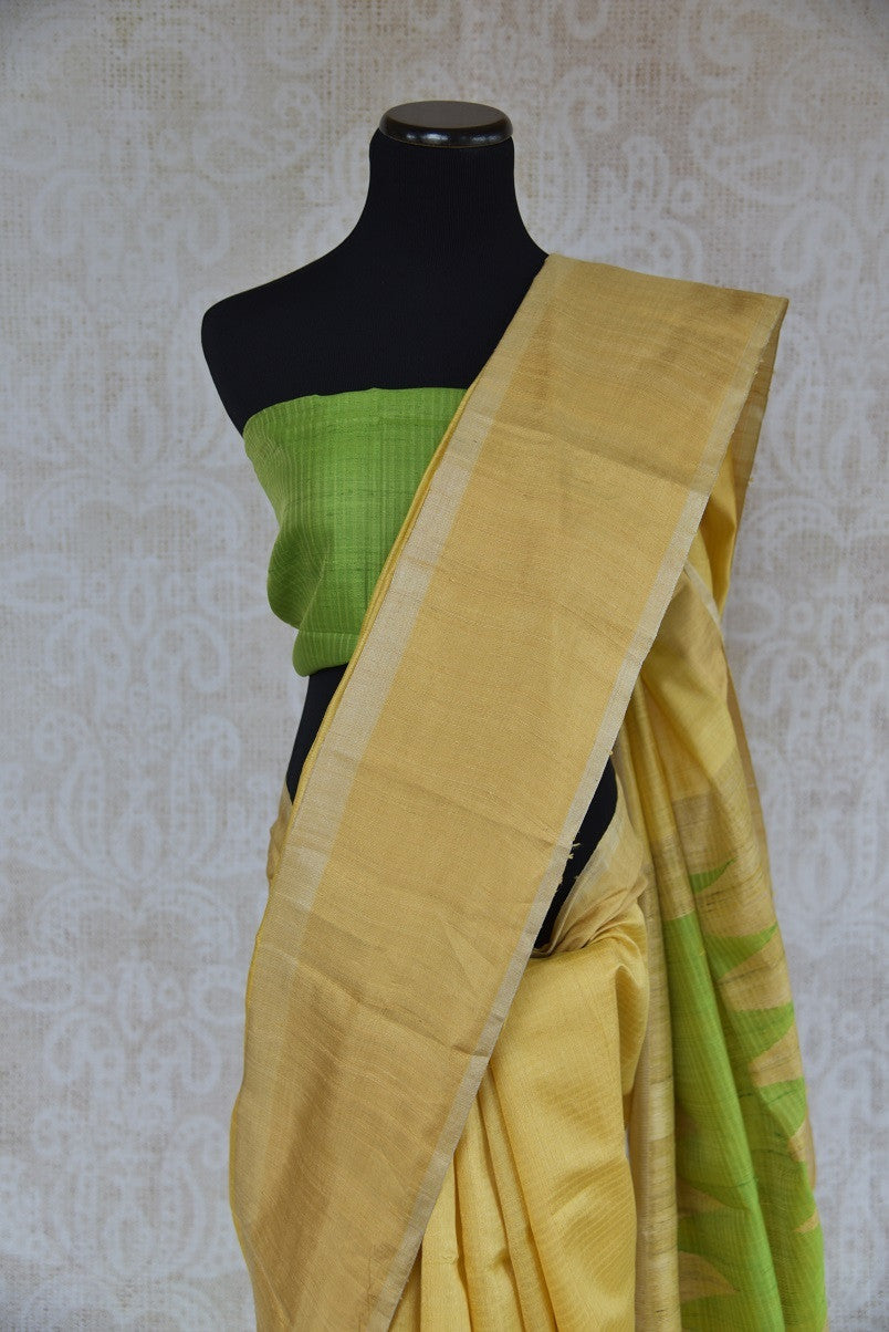 90C292 Lovely yellow saree with a simple green blouse. The simple raw silk saree, ideal for festive occasions and pujas, can be bought at our ethnic wear store in USA. Buy this versatile, wonderful and simple saree today!