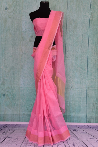 90B344 Buy this lovely organza Banarasi saree from our ethnic Indian wear store, Pure Elegance. The pink plain sari with golden border is a versatile Indian outfit and can be styled in very many ways for pujas and parties.