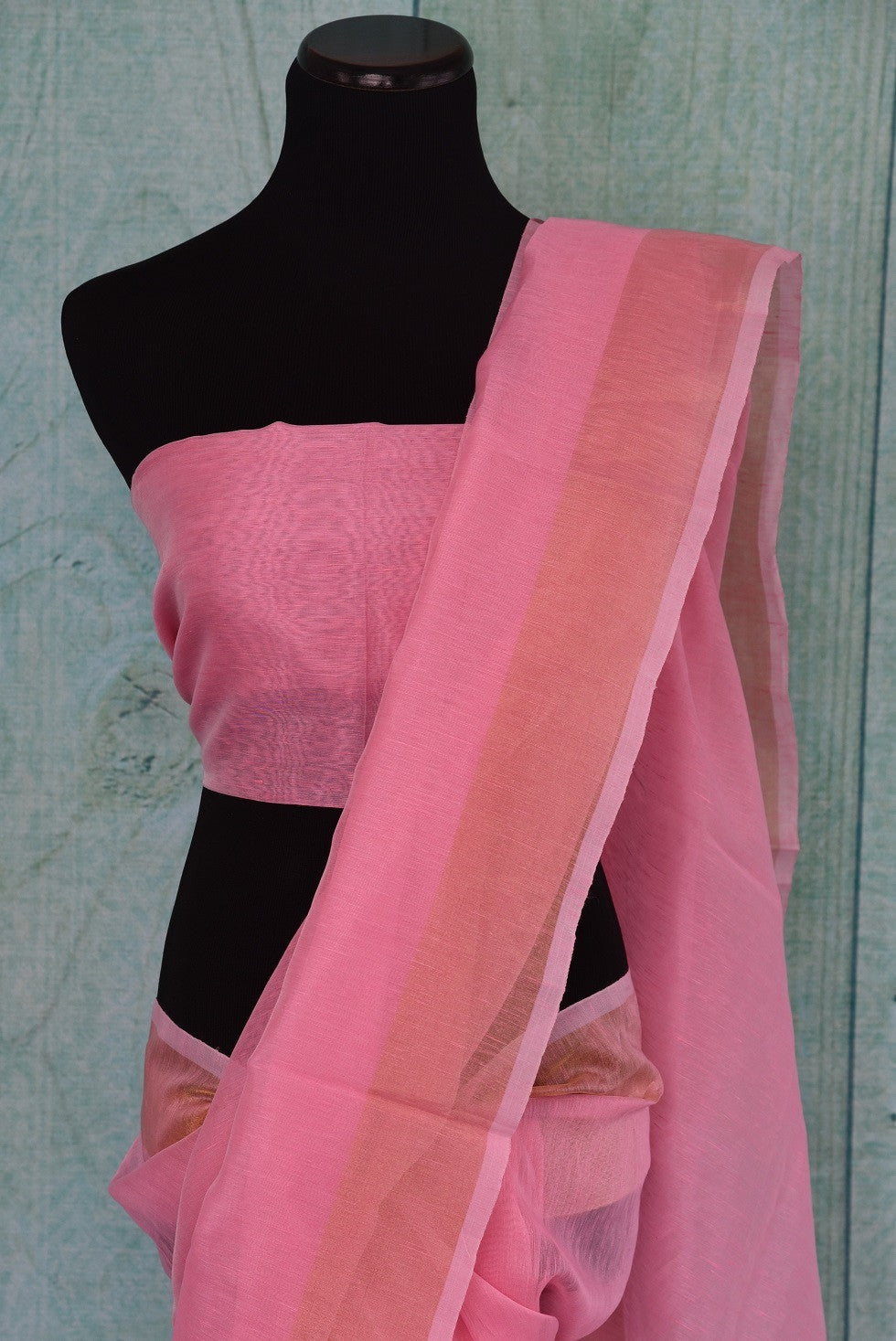 90B344 Buy this lovely organza Banarasi saree from our ethnic clothing store in USA, Pure Elegance. The pink sari with a golden border is a versatile Indian outfit and can be styled in many ways and is a lovely pick for festive occasions and pujas.