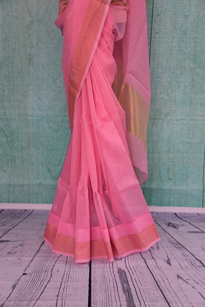 90B344 Buy this traditional organza Banarasi saree from Indian at our ethnic fashion store, Pure Elegance in USA. The plain sari in an eye-catching pink color with a golden border is a versatile Indian outfit and can be styled in very many ways for festive occasions and functions.