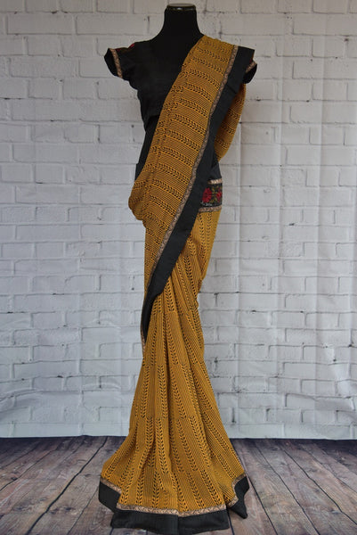 90C270 Printed georgette saree with embroidered border. The mustard yellow saree available online in USA at our store, is a lovely simple Indian outfit to add to your ethnic clothing collection. Buy this from Pure Elegance today!