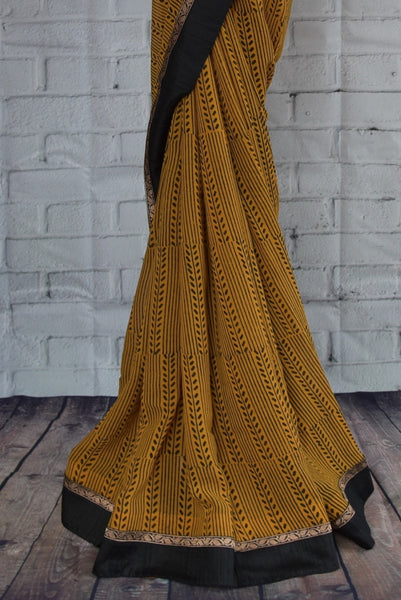 90C270 Printed georgette saree with embroidered border. The mustard yellow saree, available online in USA at our store Pure Elegance, is a lovely simple Indian outfit to add to your ethnic clothing collection. This lovely saree is sure to flutter hearts!
