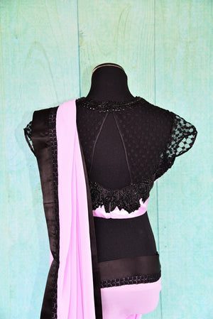 90C528 Mauve Georgette Saree With Black Border And Blouse