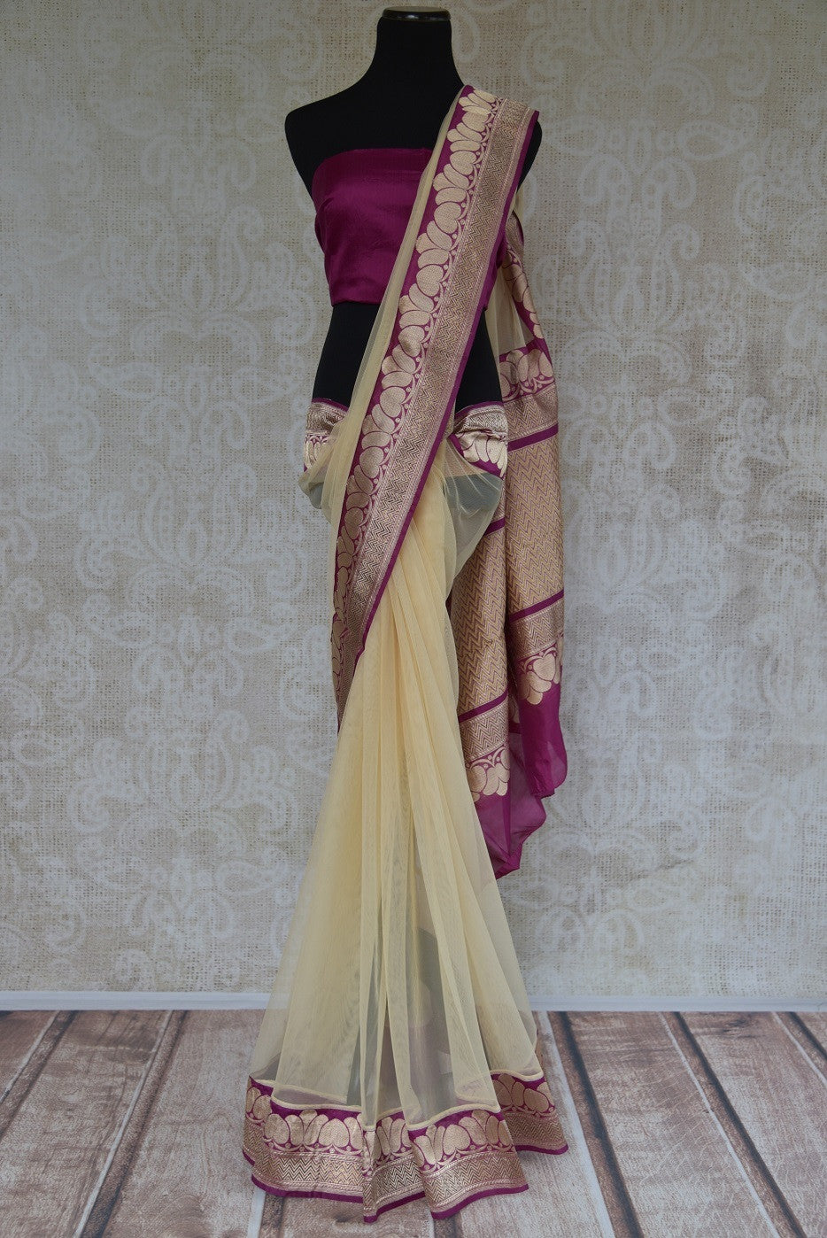 90C257 Net saree with a traditional Banarasi border. The cream and maroon saree from India can be bought at Pure Elegance - our Indian clothing store in USA. This one is a versatile pick you will love for years to come.