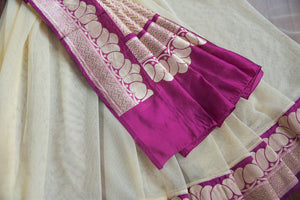 90C257 Elegant net saree with a traditional maroon Banarasi border and blouse. The simple cream saree from India can be bought at Pure Elegance - our Indian fashion store in USA.