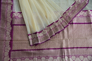 90C257 Net saree with a traditional Banarasi border. The cream and maroon saree from India can be bought at Pure Elegance - our Indian clothing store in USA. This beautiful simple saree is one that can be worn for very many occasions!