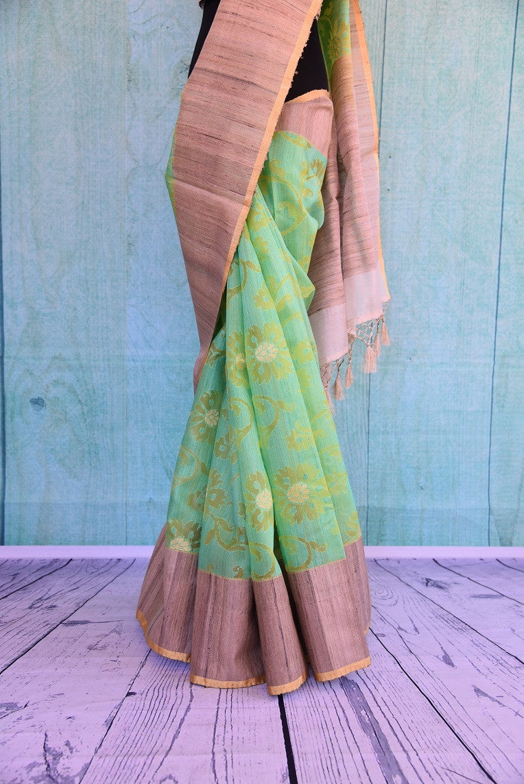 90C485 Green Organza Saree With Beige Gicha Border