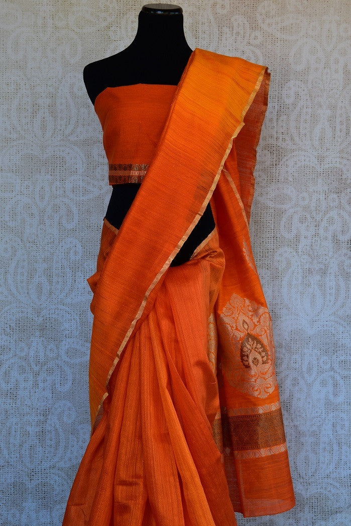 90C283 A lovely rustic orange matka silk saree with a floral zari pallu is available at our online Indian clothing store in USA. This simple saree is an evergreen pick for your ethnic wear wardrobe.