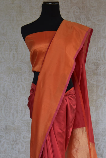 90B909  Simple red & orange Banarasi silk saree from India online at our ethnic clothing store in USA. This beautiful silk sari is the perfect party wear saree or a bridesmaid saree and can be styled in several ways.