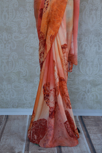 90c175 Shaded orange and white saree with a leafy print, ideal for pujas and festive days. Buy this printed crepe silk saree from India in USA at Pure Elegance - our Indian fashion store.