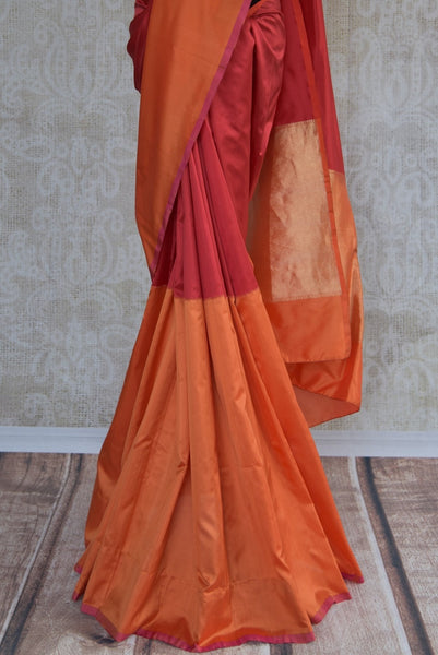 90B909  Looking for a charming plain saree? Red & orange Banarasi silk saree online at our ethnic clothing store Pure Elegance. This Indian silk sari is the perfect party wear saree or a bridesmaid saree and can be styled in very many ways!