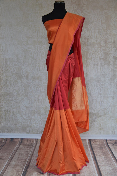 90B909  Red & orange Banarasi silk saree online at our ethnic clothing store Pure Elegance. This Indian silk sari is the perfect party wear saree or a bridesmaid saree and can be styled in very many ways!