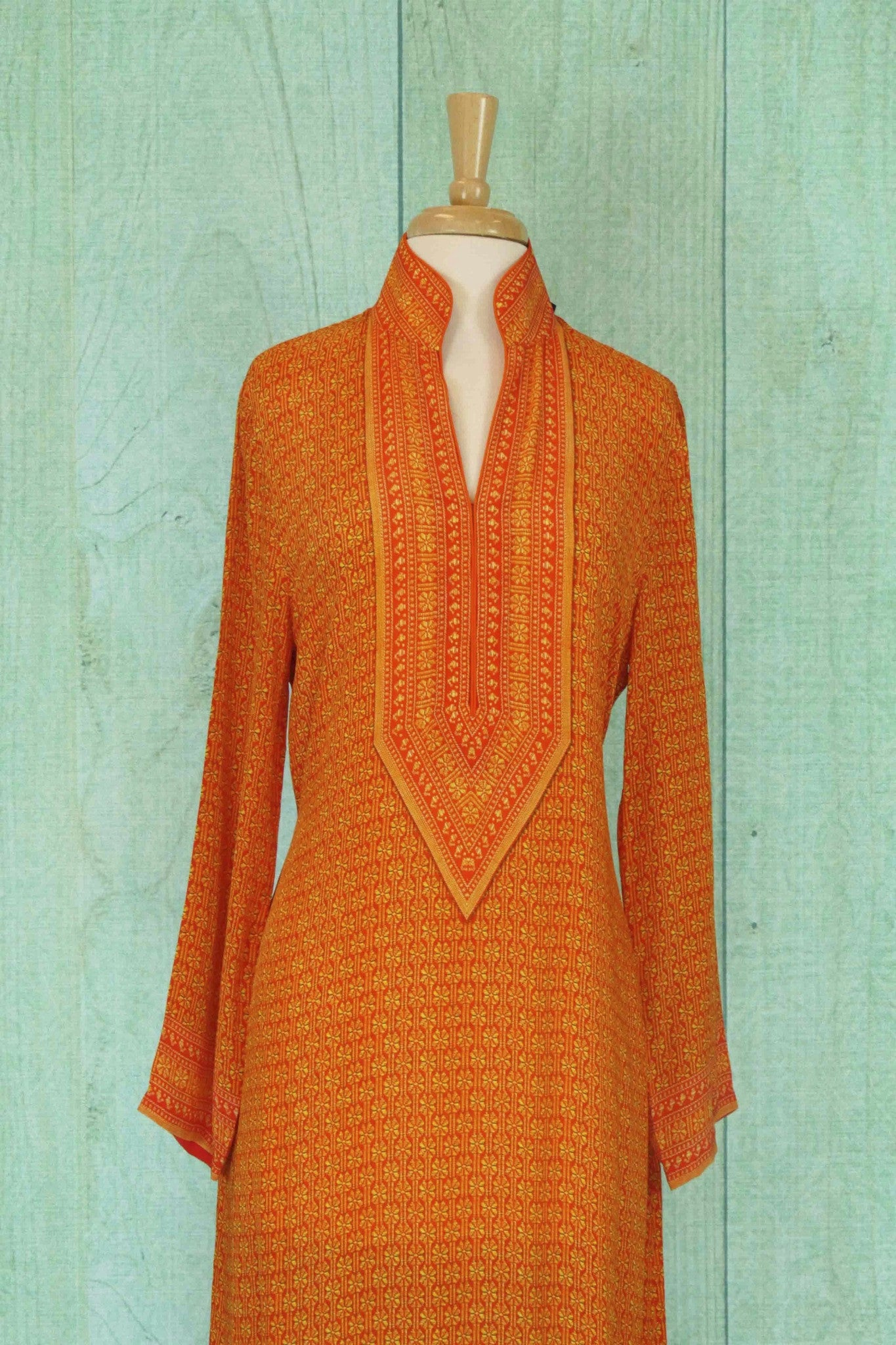 501110 Pretty Orange Suit With A Bold Brown Duppatta
