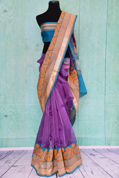 90A407 Purple, orange & blue traditional Indian saree available online at our Indian clothing store - Pure Elegance. The organza Benarasi saree for sale online is sure to keep all eyes on you!