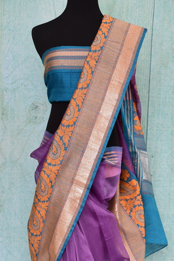 90A407 Purple, orange & blue traditional Indian saree available online at our Indian wear store - Pure Elegance. The organza Benarasi saree for sale online is sure to wow wherever you go!