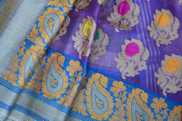 90A407 Purple, orange & blue traditional Indian saree available online at our ethnic clothing store in USA - Pure Elegance. The organza Benarasi saree for sale online is sure to turn heads wherever you go!