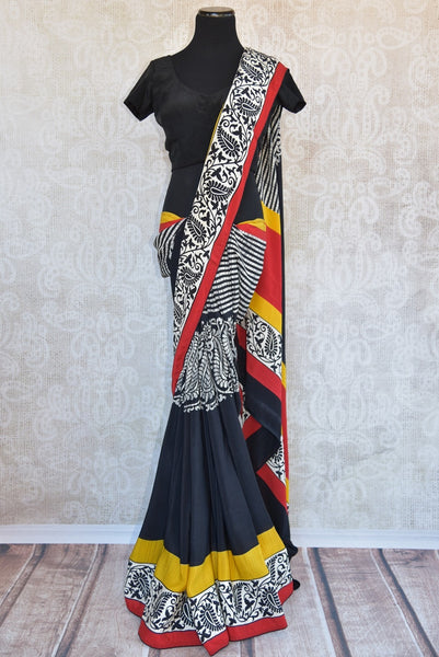 90B491 Traditional printed crepe saree available online in USA at Pure Elegance. The red and black sari with pops of yellow and red is an ideal Indian outfit for small Indian functions and pujas. Buy this timeless sari today!