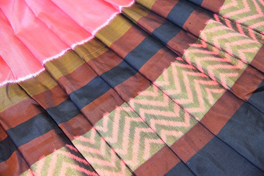Peach silk ikkat saree with hues of different colors like orange, yellow and black. Ideal saree for parties.-border