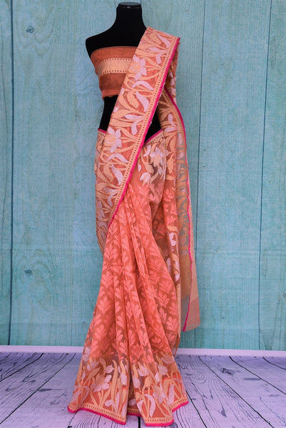90A723 Buy this peach floral saree from India online in USA at Pure Elegance. The jute saree makes for an ideal party saree, and wedding saree and is a lovely addition to your Indian clothing collection.