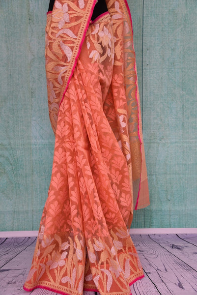 90A723 Buy this peach floral saree from India online in USA at our ethnic fashion store Pure Elegance. The woven jute saree makes for an ideal party saree, and wedding saree and is a lovely addition to your Indian clothing collection.