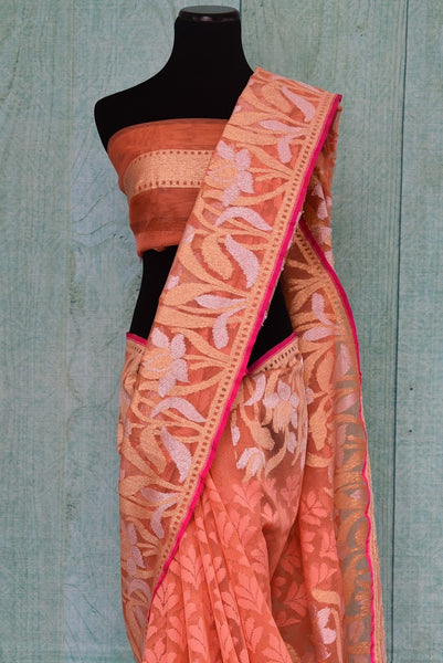 90A723 Buy this peach floral saree from India online at our store in USA - Pure Elegance. The jute saree makes for an ideal party saree, and wedding saree and will be a super addition to your Indian wear collection.