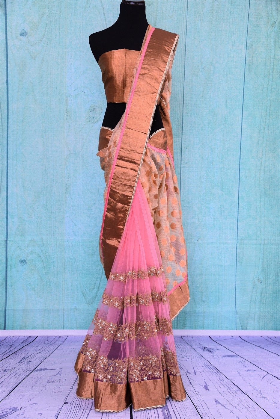 90B427 Half net, half zari kota saree with embroidery and bronze gold border. The pink party wear saree can be bought online at our Indian ethnic store Pure Elegance. This dreamy saree will be a wonderful addition your ethnic closet.