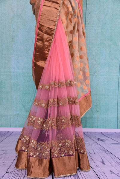 90B427 Half zari kota, half net saree with beautiful embroidery and bronze gold border. The pink party wear saree can be bought online at our Indian ethnic fashion store in USA - Pure Elegance. This lovely saree will be a great addition your ethnic closet.