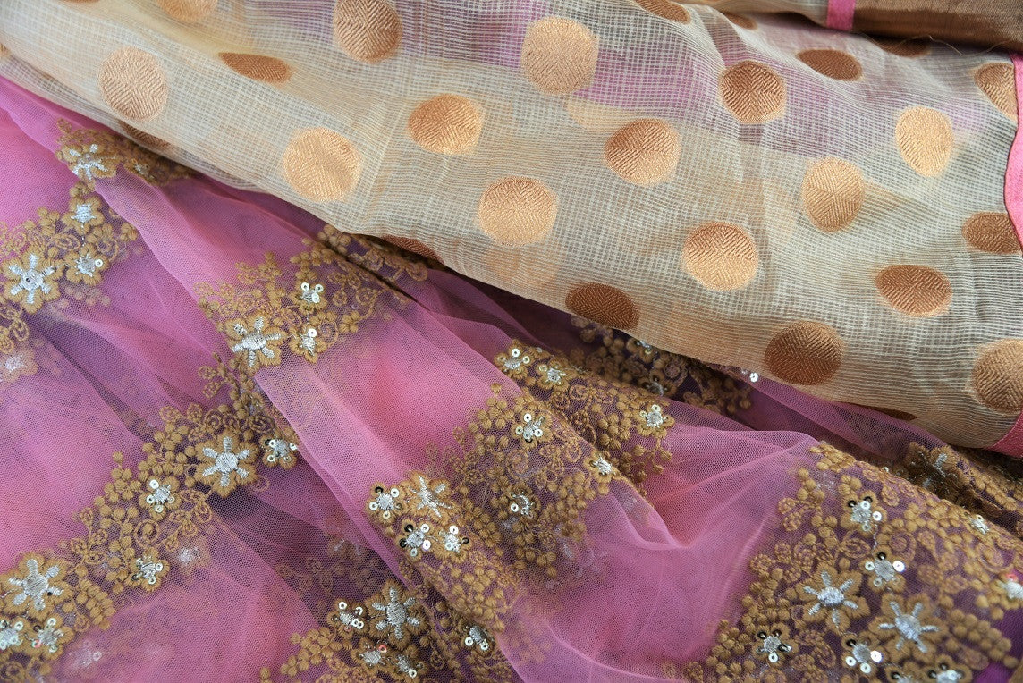 90B427 Half net, half zari kota saree with embroidery and bronze gold border. The party wear saree can be bought online at our Indian ethnic store Pure Elegance. This beautiful pink saree will be a eye-catching addition your ethnic clothing collection.