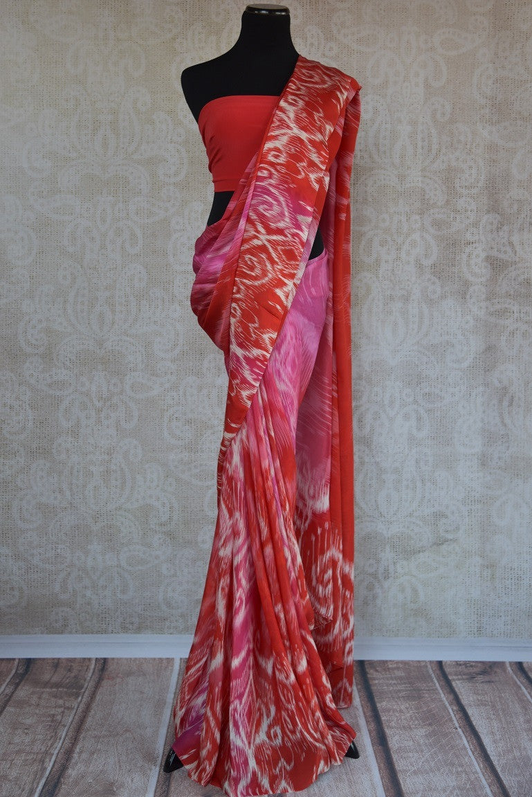 90C177 Lovely pink, red and white printed saree available at our Indian wear store online in USA. The crepe silk saree is ideal for pujas and festive occasions. This saree will be a lovely addition to your ethnic wear wardrobe.