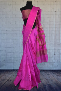 90C278 Vibrant rani pink matka Banarasi saree with classic zari pallu. The traditional saree, available online in USA at Pure Elegance is a fantastic pick for Indian wedding functions.