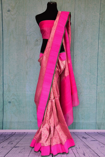 90C263 Beautiful rani pink saree with splendid traditional Indian gold weave. The ethnic saree makes for a great Indian outfit for weddings & can be bought online at our store Pure Elegance.