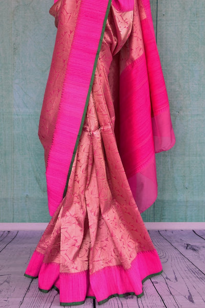 90C263 Bright rani pink saree with an intricate Indian gold weave. The bold saree makes for a great Indian outfit for weddings & can be bought at our store Pure Elegance online and in Edison, USA.