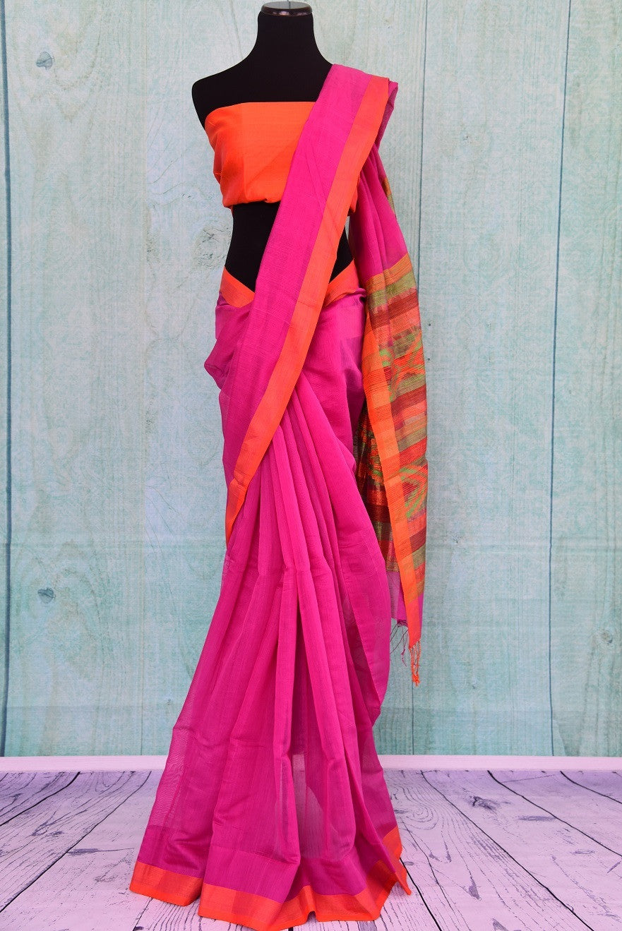 90B690 Pink & orange half matka silk & half cotton saree. The plain saree in vibrant hues is great ethnic outfit for Indian wedding functions & ethnic occasions. But this plain sari online at Pure Elegance.