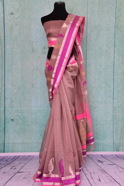 90A814 Looking to buy ethnic party sarees online? This beige kora silk saree with pops of pink and purple borders and motifs available at our Indian clothing store online in USA is the perfect pick! Look resplendent in this beautiful saree wherever you go!
