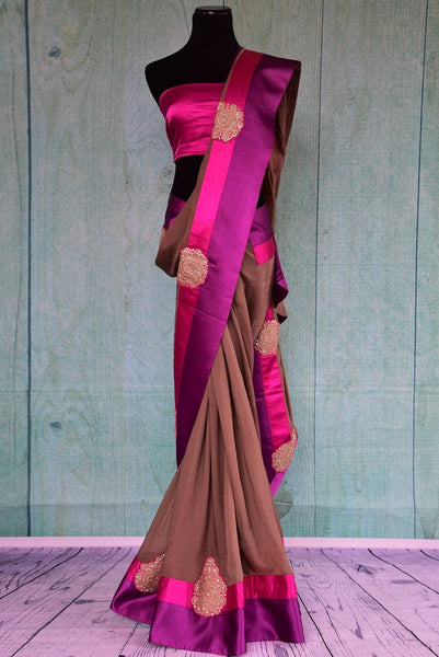 90B431 Buy this light brown, pink & purple georgette saree with satin blouse. This party wear Indian outfit is available at our store Pure Elegance online & in Edison and will be the perfect addition to your Indian wear collection.