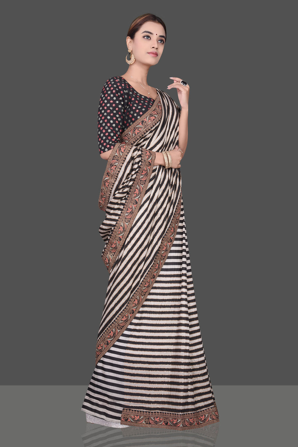 Buy stunning cream and black striped embroidered Muga silk saree online in USA with embroidered saree blouse. Shop beautiful embroidered sarees, pure silk saris, georgette sarees, designer sarees in USA from Pure Elegance Indian fashion store in USA. Shop online now.-full view