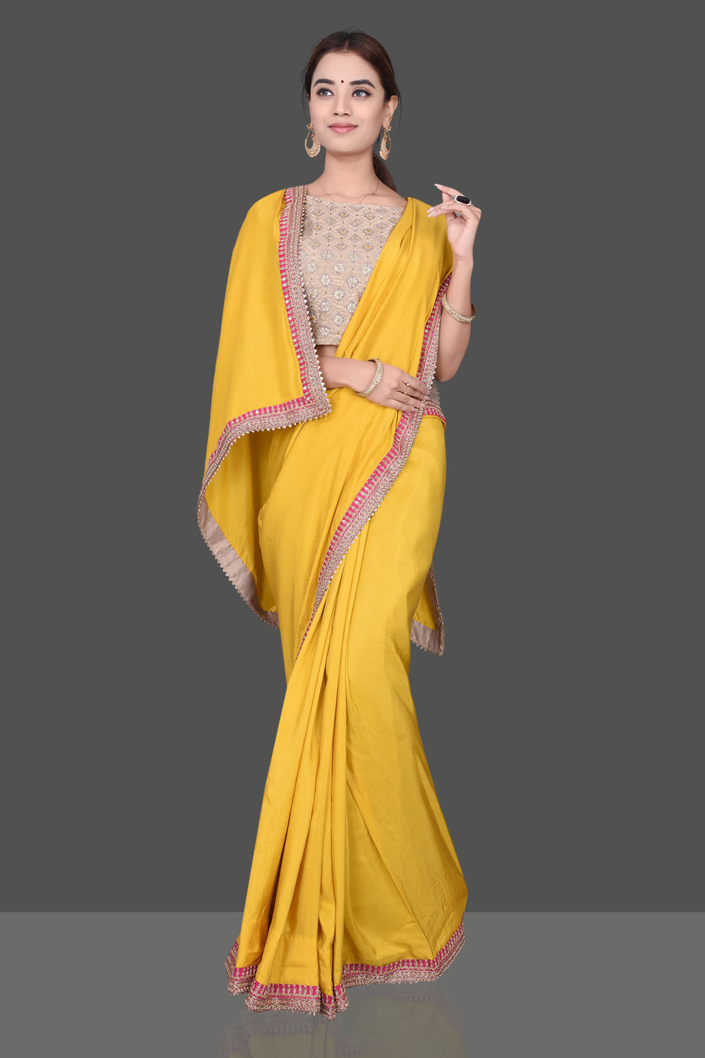 Buy gorgeous mango yellow embroidered crepe silk saree online in USA with beige embroidered Banarasi saree blouse. Shop beautiful embroidered sarees, pure silk saris, georgette sarees, designer sarees in USA from Pure Elegance Indian fashion store in USA. Shop online now.-full view