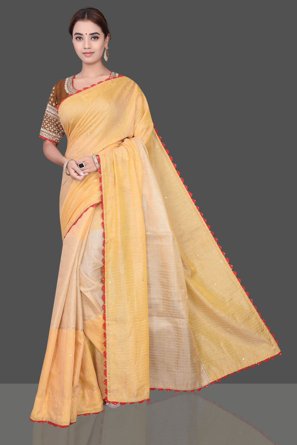 Shop attractive yellow embroidered linen saree online in USA with embroidered brown saree blouse. Shop beautiful embroidered sarees, pure silk saris, georgette sarees, designer sarees in USA from Pure Elegance Indian fashion store in USA. Shop online now.-full view
