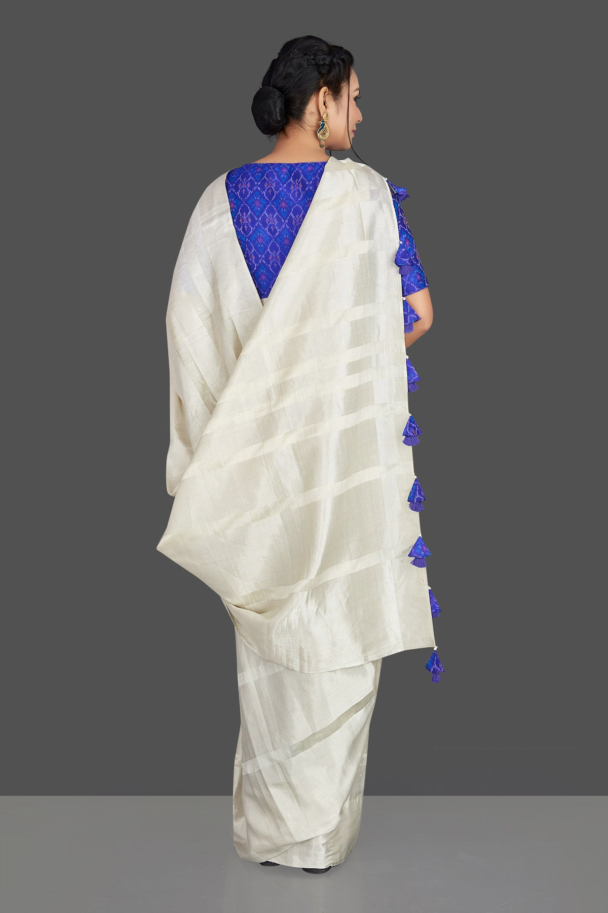 Buy lovely off-white tassar silk sari online in USA with blue patola ikkat saree blouse. Make your ethnic wardrobe rich with timeless handwoven sarees, tissue sarees, silk sarees, tussar saris from Pure Elegance Indian clothing store in USA. Find all the designer sarees for special occasions under one roof!-back