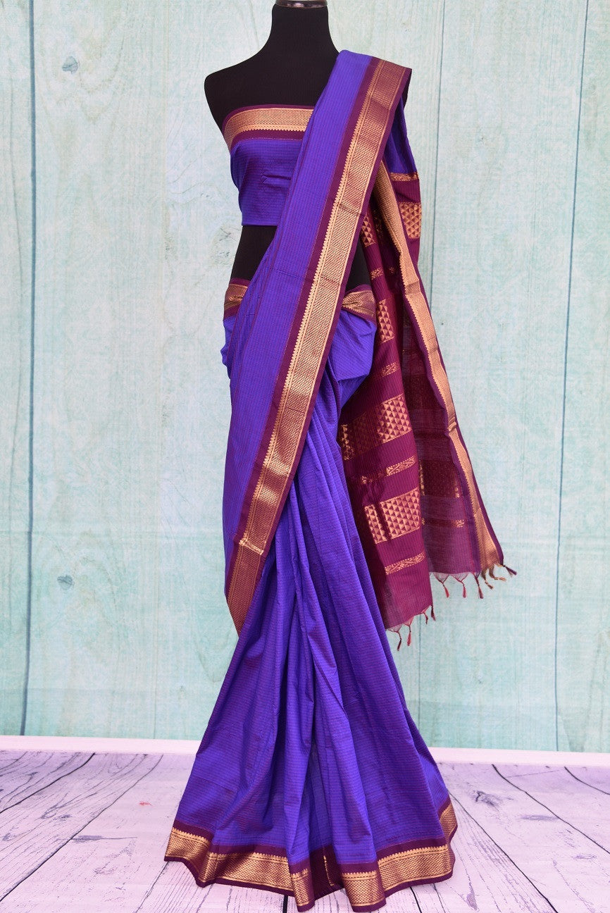 90B781 Purple Maheshwari silk saree that's simple and striking. The South Indian saree has a golden border and can be bought at our ethnic wear store online in USA. Easy to dress up or down, this saree from India can be worn at a variety of occasions.