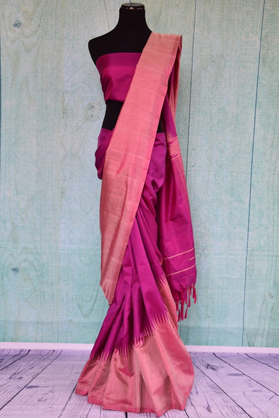 90B384 A classic Bangalore silk saree in a royal shade of purple with a traditional gold temple border. Buy this party wear saree online in USA at our Indian fashion store Pure Elegance and get set have all eyes on you.