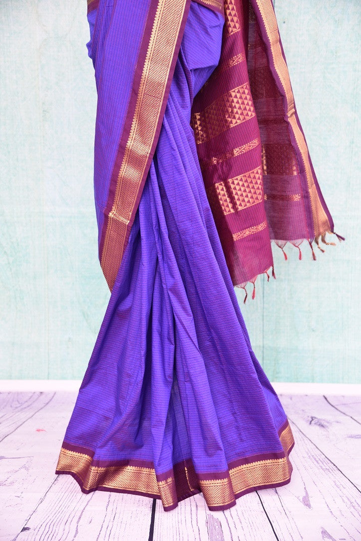 90B781 Purple Maheshwari silk saree that's simple and striking. The South Indian saree has a golden border and can be bought at our ethnic wear store online in USA. Easy to dress up or down, this saree from is an evergreen and versatile pick!