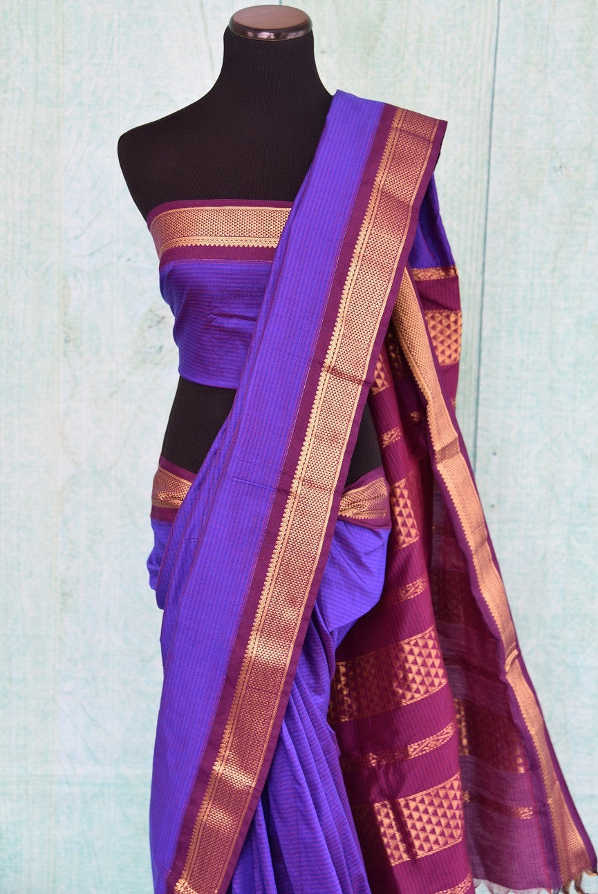 90B781 Purple Maheshwari silk saree that's simple, yet bold. The traditional South Indian saree has a classic golden and red border and can be bought at our ethnic clothing store online in USA. Easy to dress up or down, this saree can be worn at a variety of occasions.