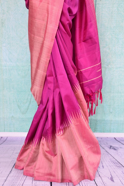 90B384 A ravishing Bangalore silk saree in a mesmerizing shade of wine purple with a traditional gold temple border. Buy this lovely ethnic saree online in USA at our Indian clothing store Pure Elegance and get set have all eyes on you.