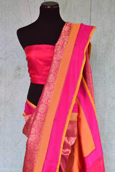90a900 Pink Banarasi saree with orange border that makes for a lovely Indian outfit. Buy this traditional saree at our Indian fashion store online in USA - Pure Elegance and get ready to get them glances!