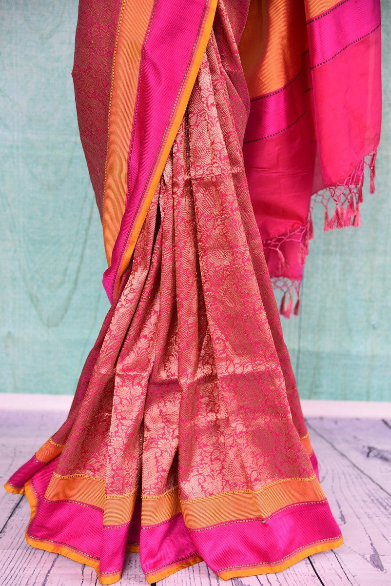 90a900 Orange & pink Banarasi saree that makes for an evergreen Indian outfit for pujas and festive occasions. Buy this traditional saree at our online Indian wear store in USA - Pure Elegance.