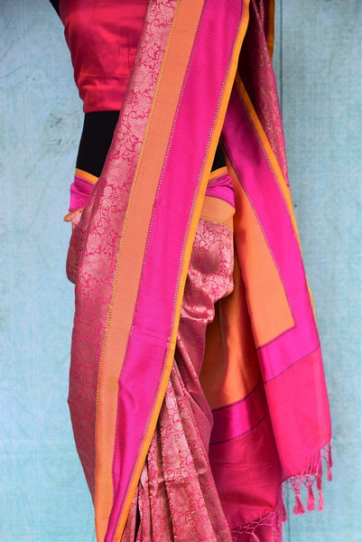 90a900 Orange & pink Banarasi saree that makes for a timeless Indian outfit. Buy this vibrant saree at our Indian clothing store online in USA - Pure Elegance and you'll love this beautiful addition to your ethnic wardrobe.