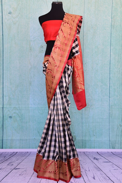 90B318 This checked muga saree has both, traditional & modern elements. The black, white and red sari is the perfect Indian outfit for wedding functions and for parties and is available at our ethnic clothing store Pure Elegance.