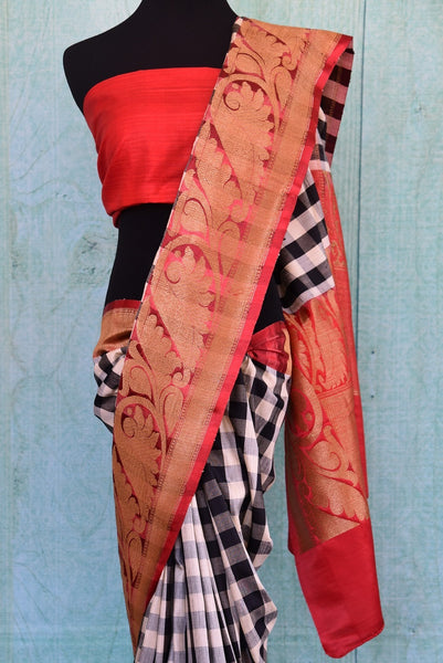 90B318 Black, white and red, this muga saree has both, traditional & modern design elements. The checked party sari is a lovely pick for wedding functions and for parties and is available at our ethnic wear store online in USA - Pure Elegance.