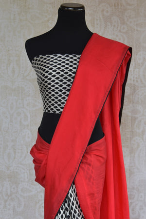 90A474 Give your ethnic wear collection a cool contemporary touch with this red, white & black, checked saree. This half-n-half crepe and silk saree can be purchased from our Indian fashion store in USA - Pure Elegance